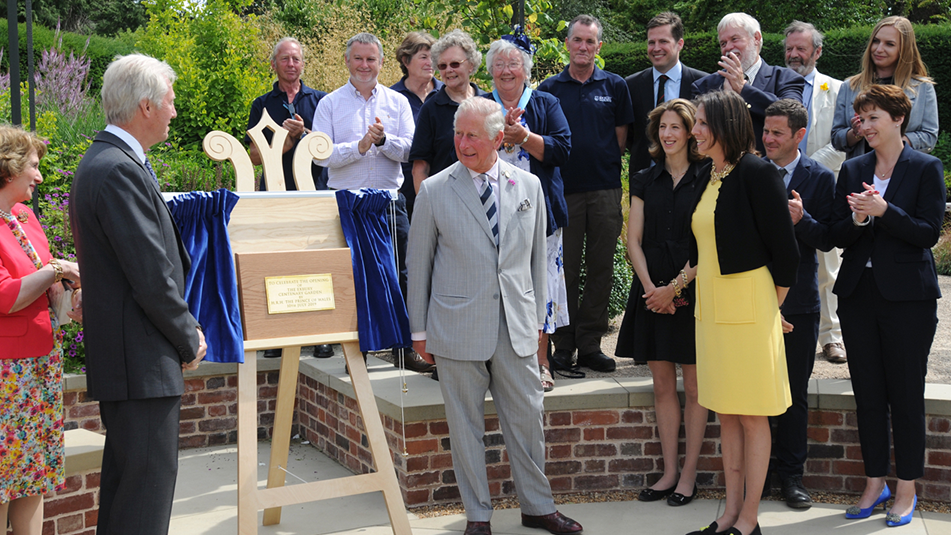 The Prince of Wales unveiling the plaque in the new Centenary Garden at Exbury Gardens with members of the de Rothschild family estate staff and contractors involved in the construction of the garden sml
